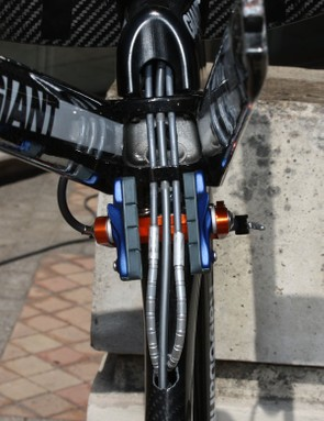 The aluminium fork crown directs the cables straight back towards the down tube. Giant say extra flexible sections of housing such as Nokon are necessary in this area for optimum function and full production bikes will feature an aluminium ring to protect the edges of the down tube access hole