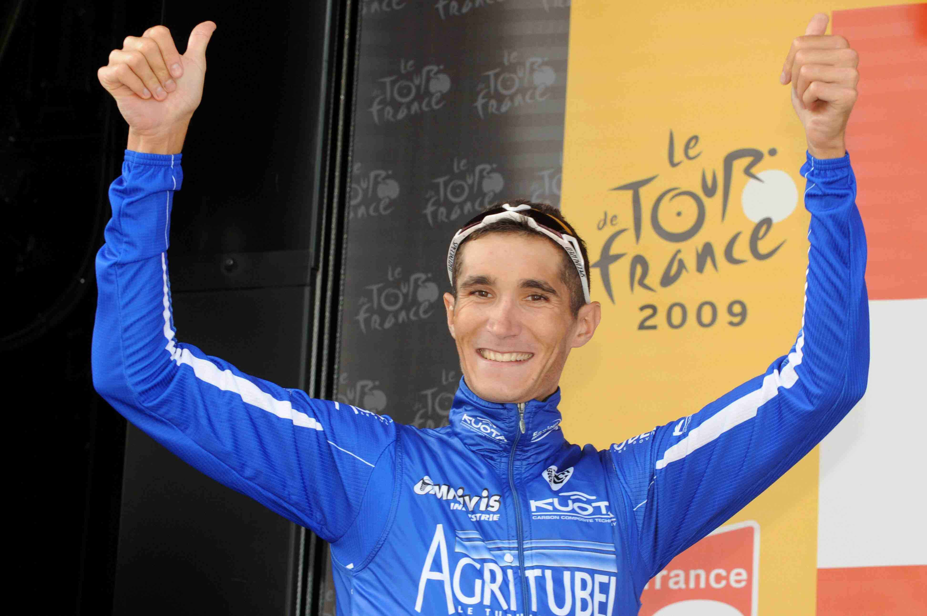Stage 7 winner Brice Feillu celebrates on the podium Friday.