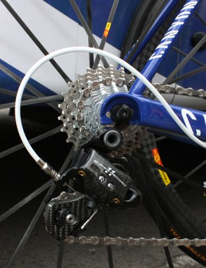 A Campagnolo Super Record rear derailleur is bolted to the rear end of Evans' Canyon Ultimate CF Pro.