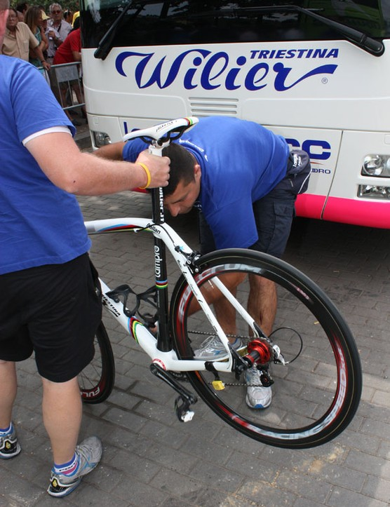 No need for a repair stand when there are two mechanics on hand.