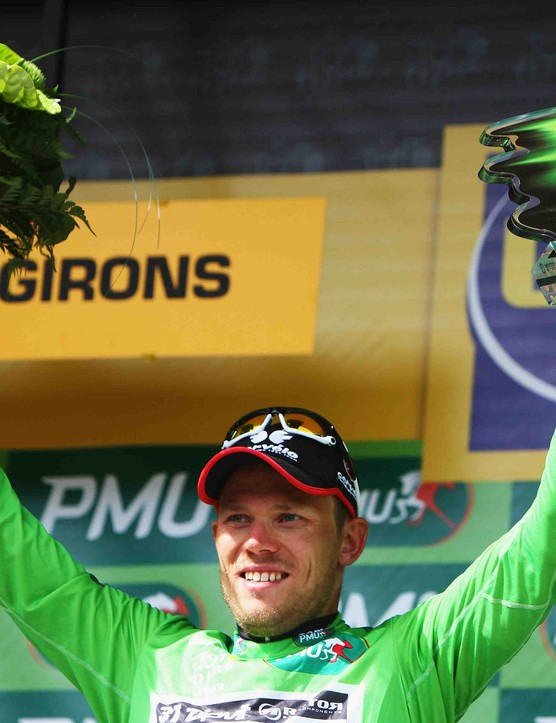 Cervelo's Thor Hushovd takes over wearing the sprinter's green jersey from Mark Cavendish Saturday evening.