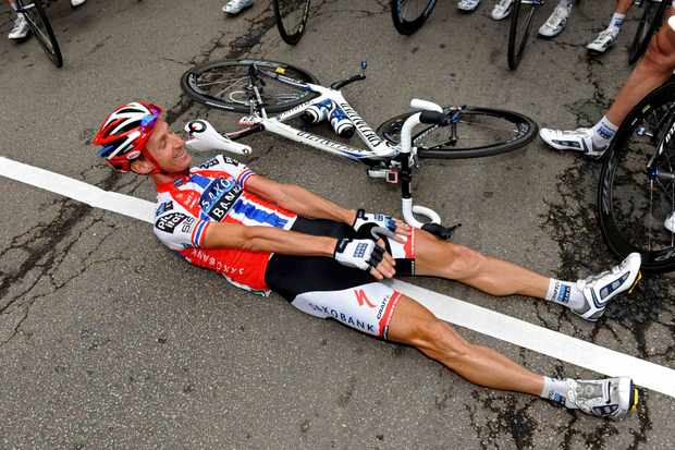 Kurt-Asle Arvesen of Norway and Team Saxo Bank jokes as he lays on the startline before the start of the radio-free 10th stage of the 2009 Tour de France from Limoges to Issoudun on July 14, 2009 in Limoges, France. The Norwegian broke his collarbone 87km into the stage.