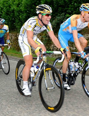 Fellow Brits and former teammates Mark Cavendish (L) and Bradley Wiggins share a laugh during Stage 10 of the 2009 Tour.