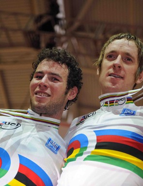 Britain's Mark Cavendish (L) and his compatriot Bradley Wiggins pose with their gold medals as they celebrate on the podium their victory in the men's Madison finals in the UCI Track Cycling World Championships on March 29, 2008 at the Manchester velodrome.