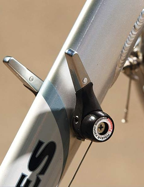 Stubby down tube shifters click up and down the seven-speed freewheel easily