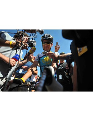 Lance Armstrong chats up the media before stage 12 Thursday.
