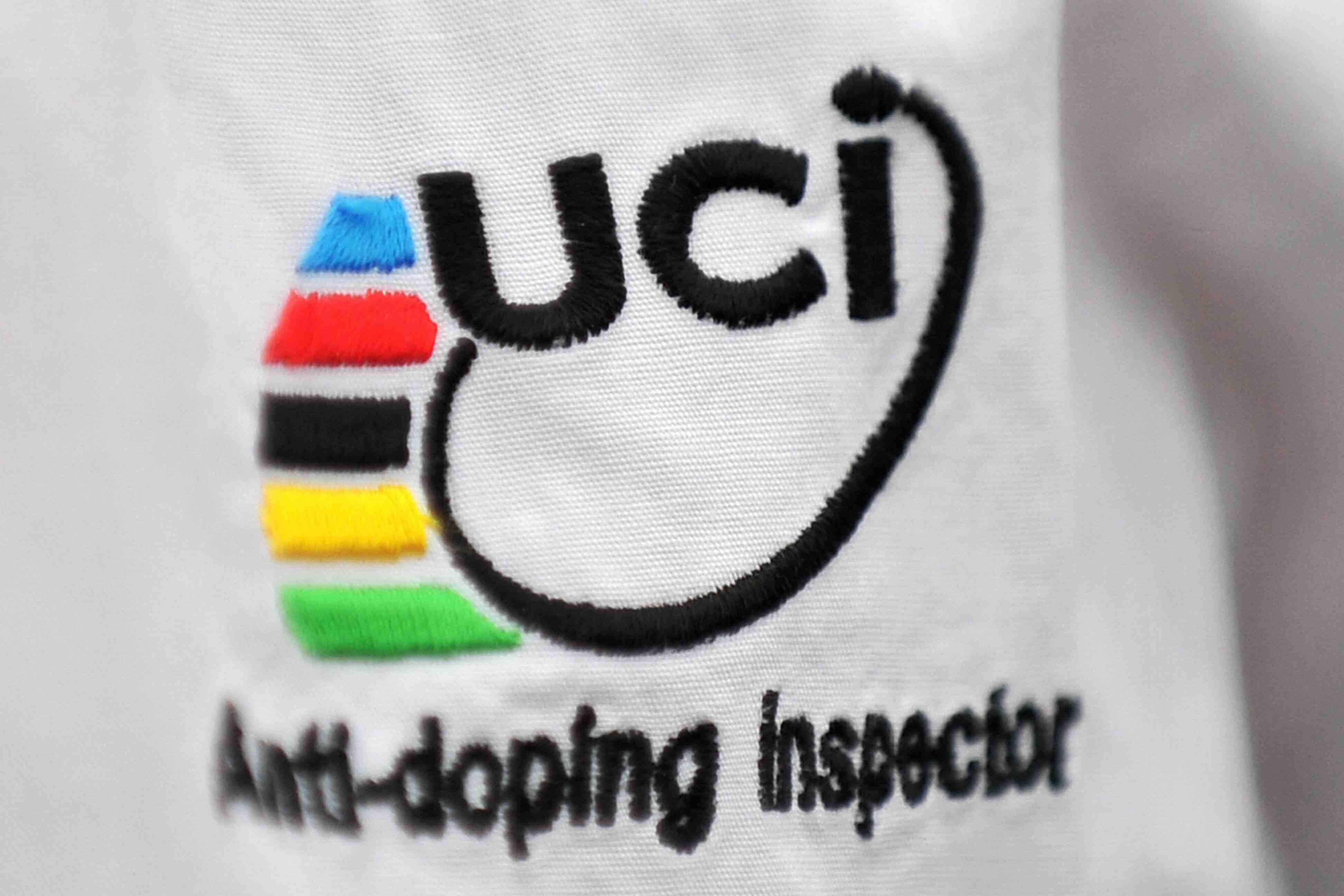 A close-up photo of a UCI anti-doping inspector's shirt during the 2009 Tour.