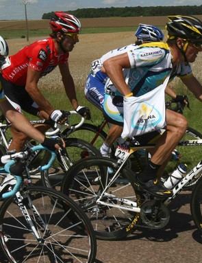 Lance Armstrong (R) cruises through the feed zone during the 2009 Tour.