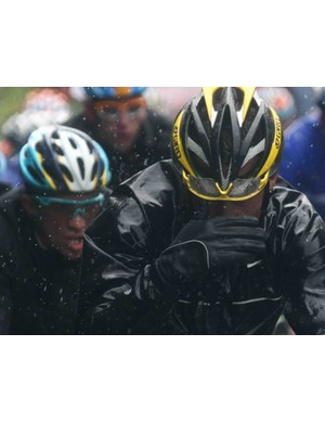 Astana teammates Alberto Contador (L) and Lance Armstrong fight through a wet stage 13 of the 2009 Tour.