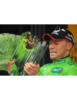 Cervelo's Thor Hushovd raises the green jersey wearer's daily trophy.