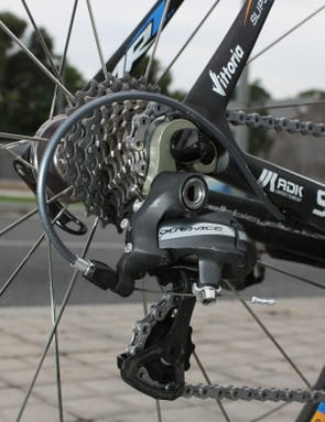 The Dura-Ace rear derailleur is bolted to a meaty alloy hanger.