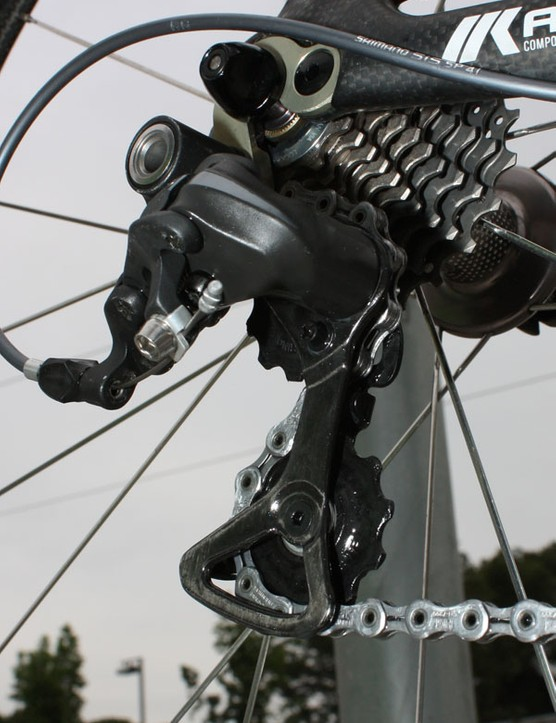 The new Dura-Ace rear derailleur uses a carbon fiber pulley cage.