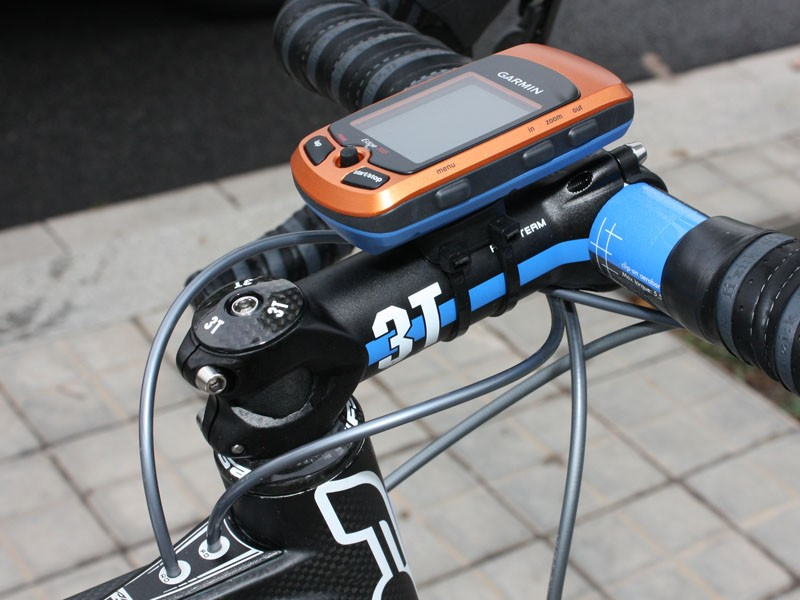 A Garmin Edge 705 GPS-enabled computer is strapped to a 3T ARX Team stem.