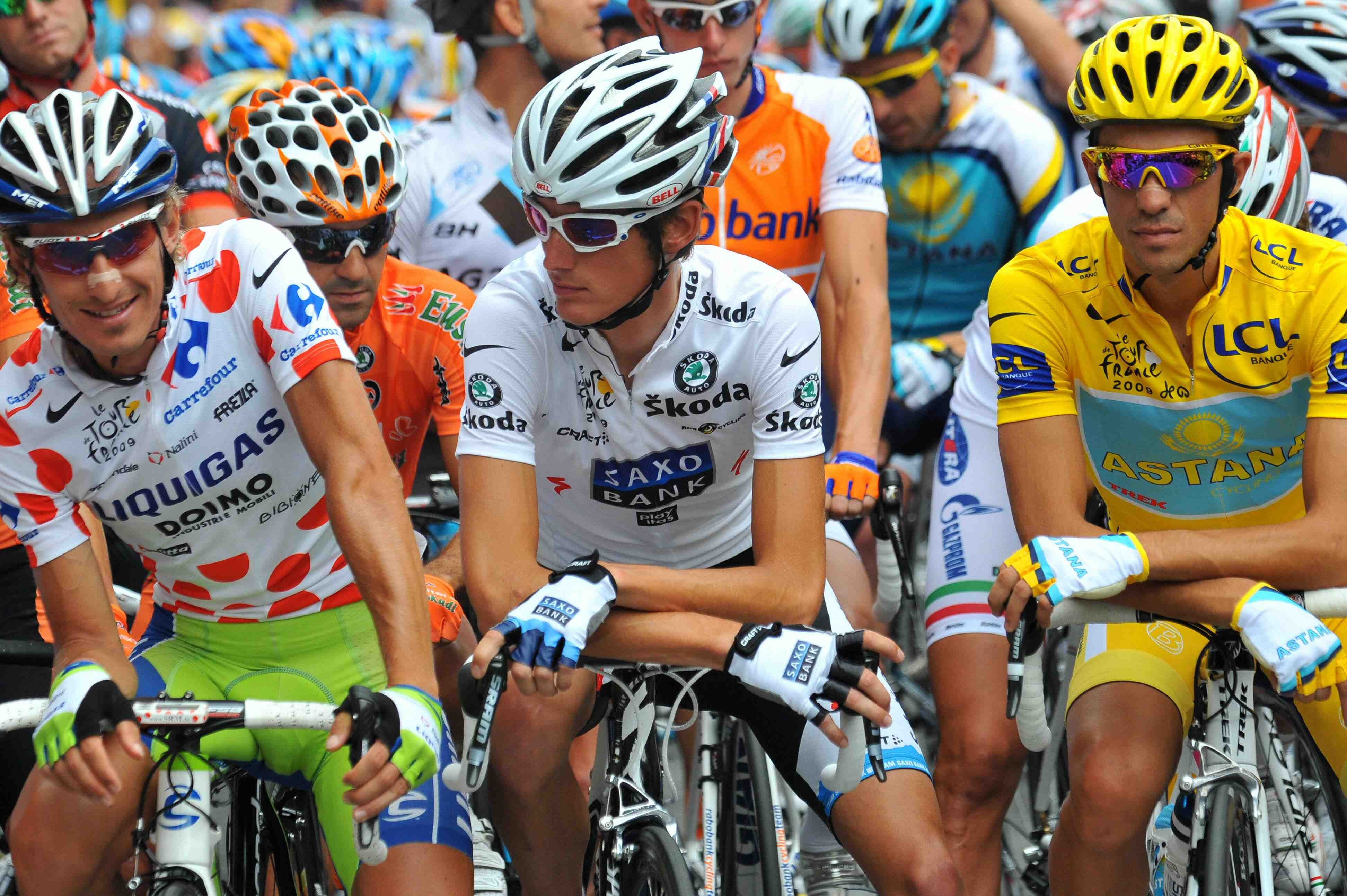 Franco Pellizotti lines up next to best young racer Andy Schleck and yellow jersey Alberot Contador before the start of stage 16.