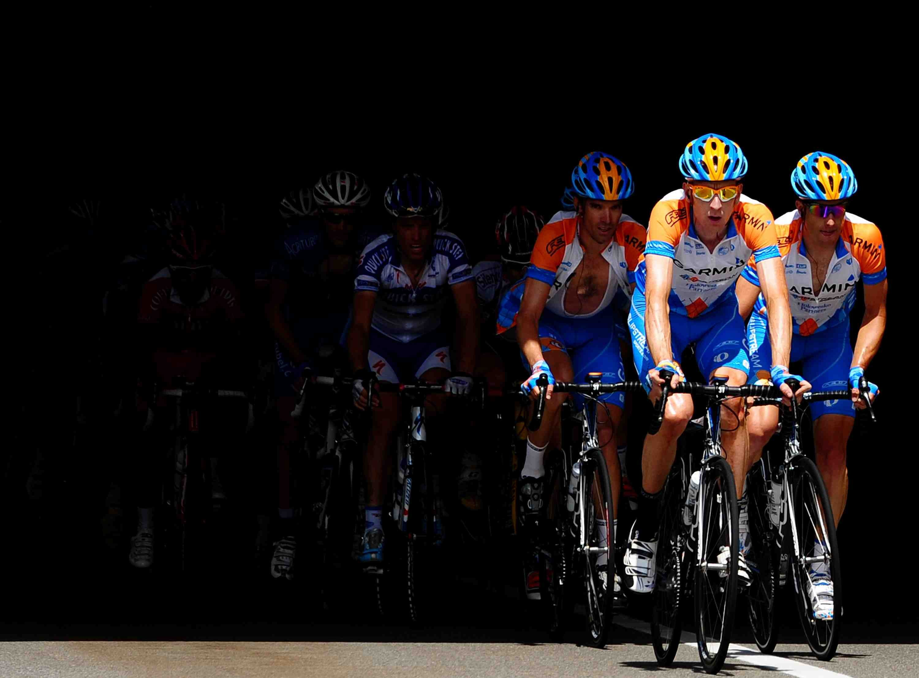 Garmin's Bradley Wiggins leads teammates David Millar and Christian Vande Velde on stage 16.