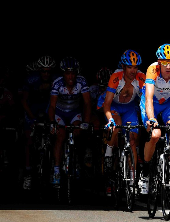 Garmin's Bradley Wiggins leads teammates David Millar and Christian Vande Velde on stage 16.