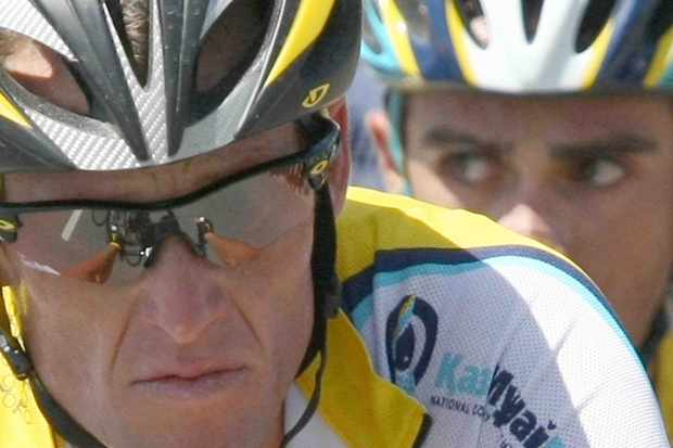 Lance Armstrong with a nervous-looking Alberto Contador peering over his shoulder recently during the 2009 Tour.