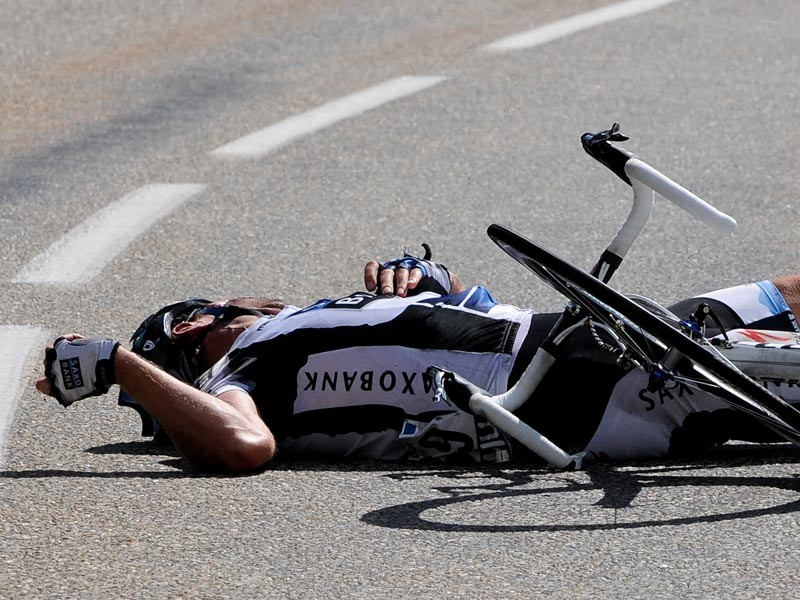 Jens Voigt of Germany and team Saxo Bank lies on the road during stage 16 of the 2009 Tour de France from Martigny to Bourg-Saint-Maurice on July 21