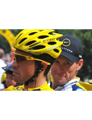 Astana teammates Alberto Contador and Lance Armstrong before the start of stage 17.