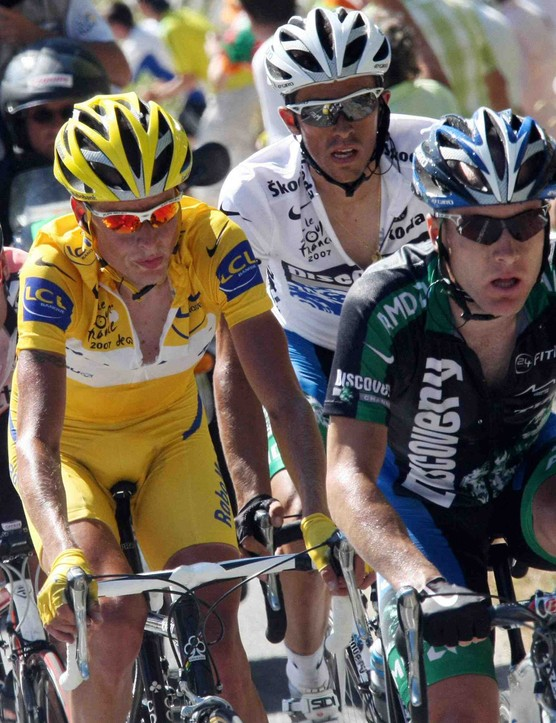 Cadel Evans (L), Michael Rasmussen (in yellow), Alberto Contador and Levi Leipheimer duke it out during stage 16 of the 2007 Tour de France.