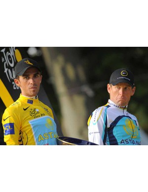Contador and Armstrong look on bemusedly as the Danish national anthem is played instead of the Spanish one