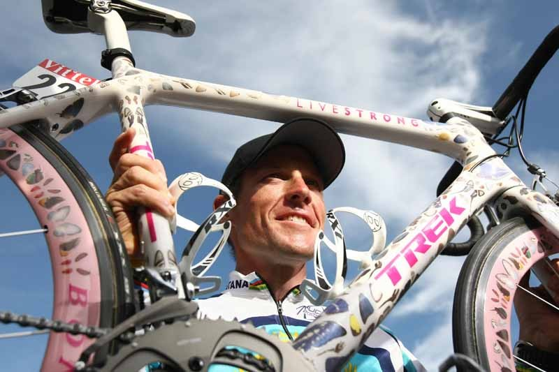 Lance Armstrong with one of his Damian Hirst painted bikes