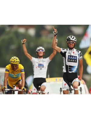 Frank Schleck of Luxembourg and Saxo Bank crosses the finish line in front of Alberto Contador and Andy Schleck to win stage 17 of the 2009 Tour de France from Bourg-Saint-Maurice to Le Grand Bornand on July 22, 2009.