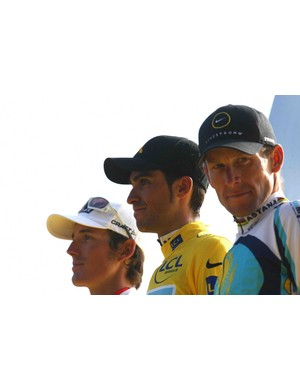 Armstrong on the final podium with Andy Schleck (L) and Alberto Contador July 26, 2009 in Paris.