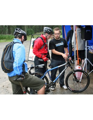 A rider is shown how to operate his Garmin Edge at the Garmin MTB Day, Glentress