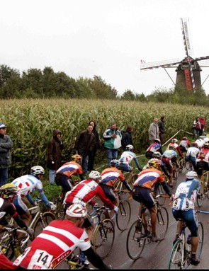 The peloton approaches a windmill during the 1998 World Road Cycling Championships between Valkenburg and Maastricht in Belgium.