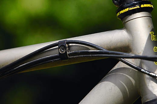 The cabling on our sample bike will be rerouted, but the machined clip-in threaded insert design will remain