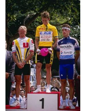 1989 Tour de France podium: Greg LeMond (C), flanked by Laurent Fignon (L) and Pedro Delgado.