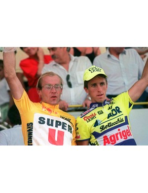 Yellow jersey Laurent Fignon and Greg LeMond on the podium after stage 19 of the 1989 Tour de France.