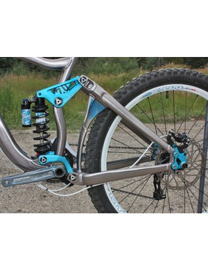 The stout rear triangle features a beefy Y-shaped brace joining the chainstays and seatstays