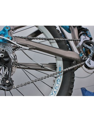 The rear derailleur housing is routed through the chainstay for a tidier appearance