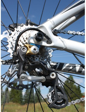 The rear derailleur housing is routed through the chainstay