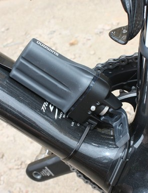 A small control box is attached to the brake housing and provides the interface for derailleur adjustments and battery life indicators