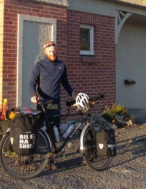 James Bowthorpe takes time out for a photo during his round-the-world cycle