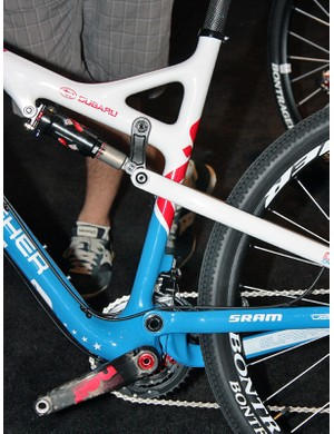 The seat tube is offset ahead of the bottom bracket to make more room for the tucked-in rear wheel.