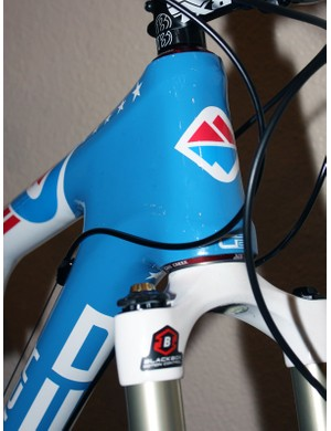 The red, white and blue theme carries through right to the head tube badge.
