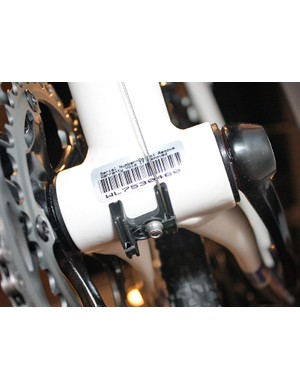 Press-fit bottom bracket cups save a few grams and also allow for wider chain stay spacing.