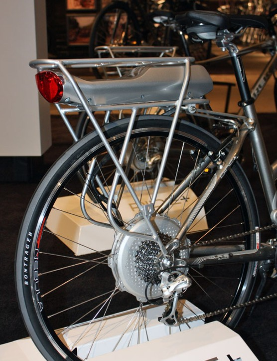 The rechargeable battery pack slots into the proprietary rear rack while the motor is wholly housed within the rear hub