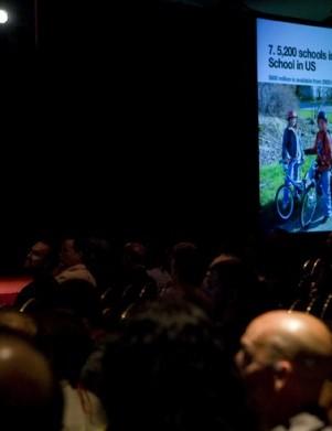 Trek president John Burke addresses the crowd at the recent Trek World dealer summit in Madison, Wisconsin.