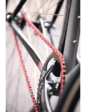 The red chain is a stylish touch