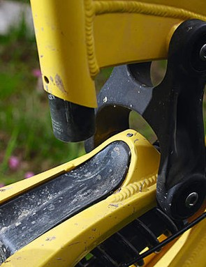 The shock protector helps guard against rear wheel muck