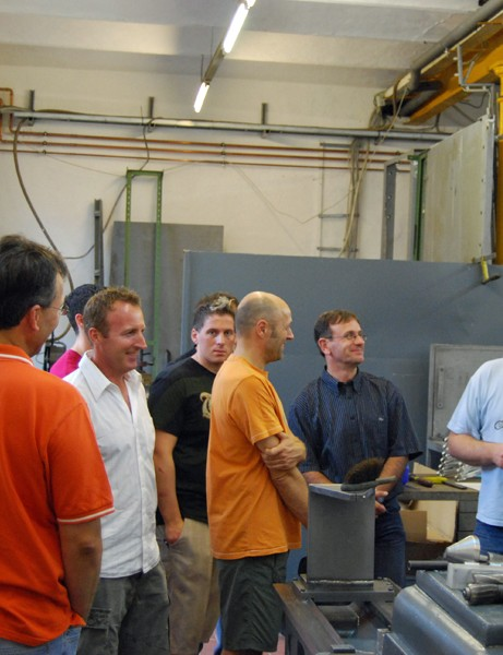 Kalle Nicolai (right) shows customers around his factory in Lubbrechtsen, Germany