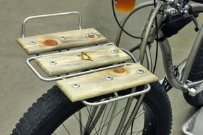 The front rack is amply sized for… beer?