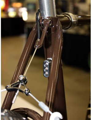 The rear light is bolted right to the seat tube and the rear brake hanger is neatly integrated into the seat binder.