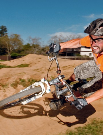 Mark Weir tearing up the dirt in his backyard pump track in Novato, California.