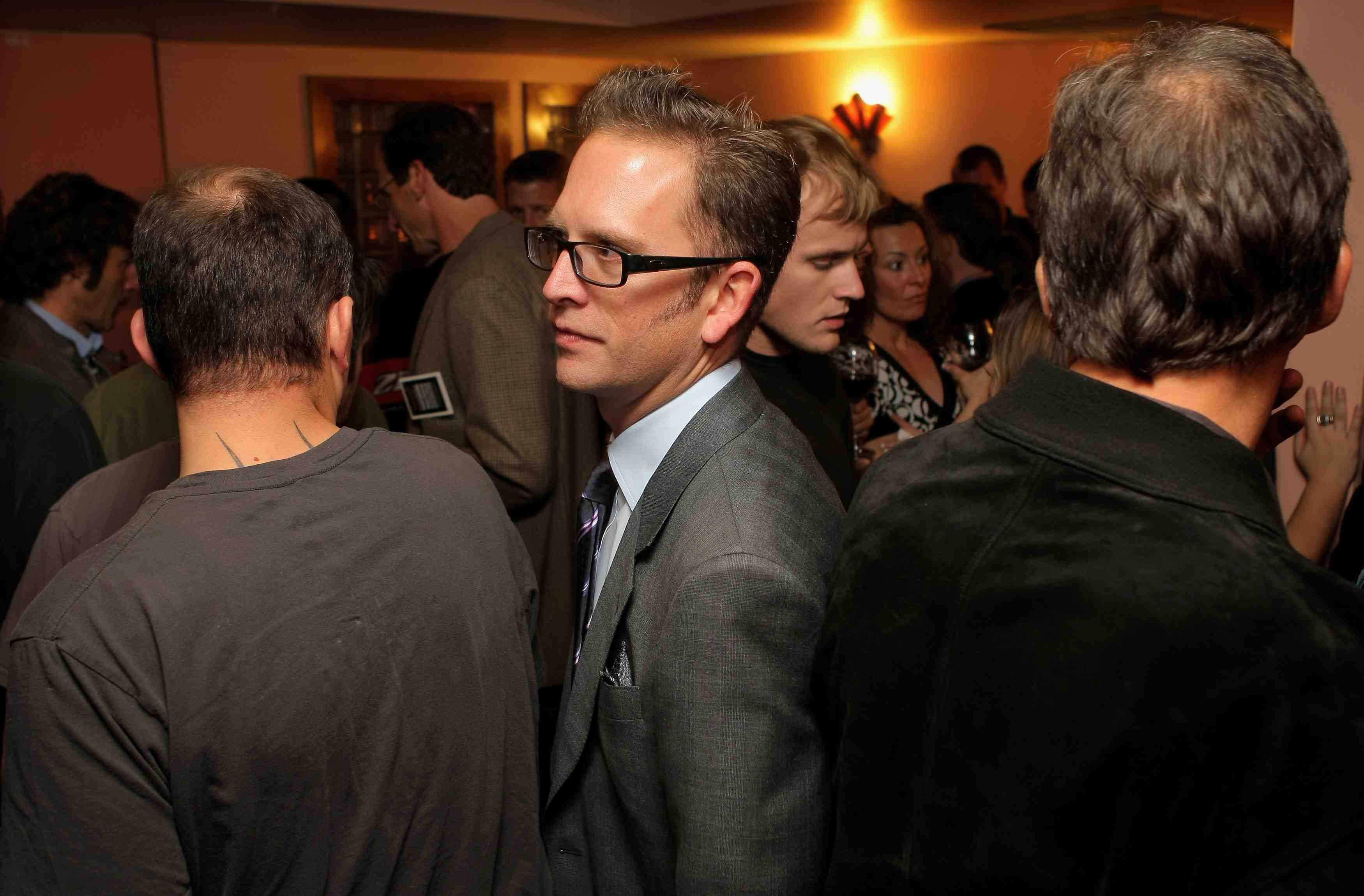 Garmin-Slipstream director Jonathan Vaughters (C).